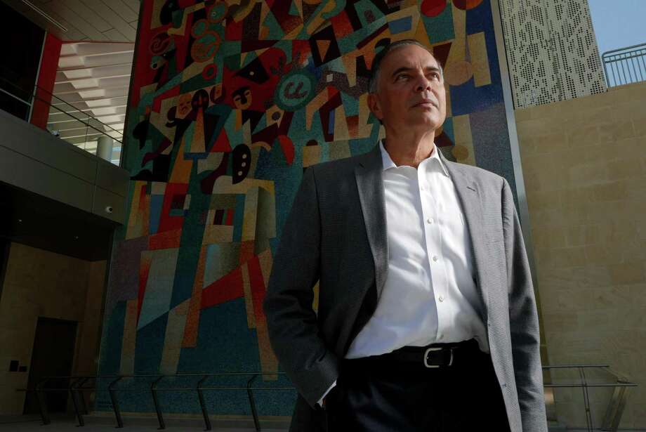 Andrés Andujar, CEO of Hemisfair Park Redevelopment Corporation, has worked to improve and transform the downtown site into a family friendly space. He stands by a Carlos Mérida work of art that was on display at HemisFair '68. Photo: Billy Calzada /San Antonio Express-News / San Antonio Express-News