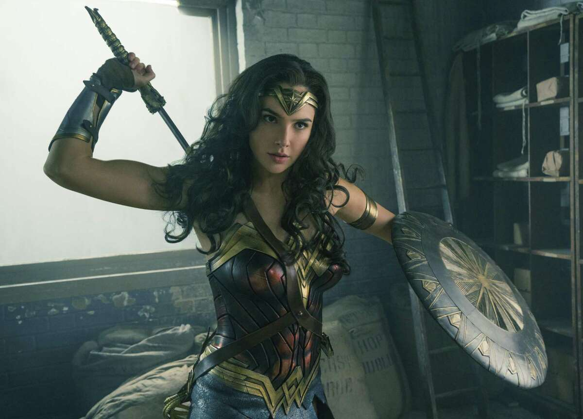 """This image released by Warner Bros. Entertainment shows Gal Gadot in a scene from """"Wonder Woman."""" Six Flags Fiesta Texas is getting its first Golden Lasso Coaster slated to open in early March."""