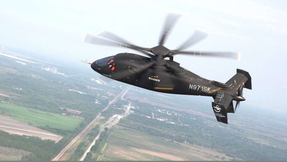 "A file image of the Sikorsky S-97 Raider whose tandem rotor sets and rear ""pusher prop"" design elements the Stratford, Conn. based manufacturer is including in its SB>1 Defiant prototype it is promoting alongside Boeing for the U.S. Department of Defense's ""Future Vertical Lift"" competition that could govern military rotorcraft over a half century. (Image courtesy Lockheed Martin) Photo: /"