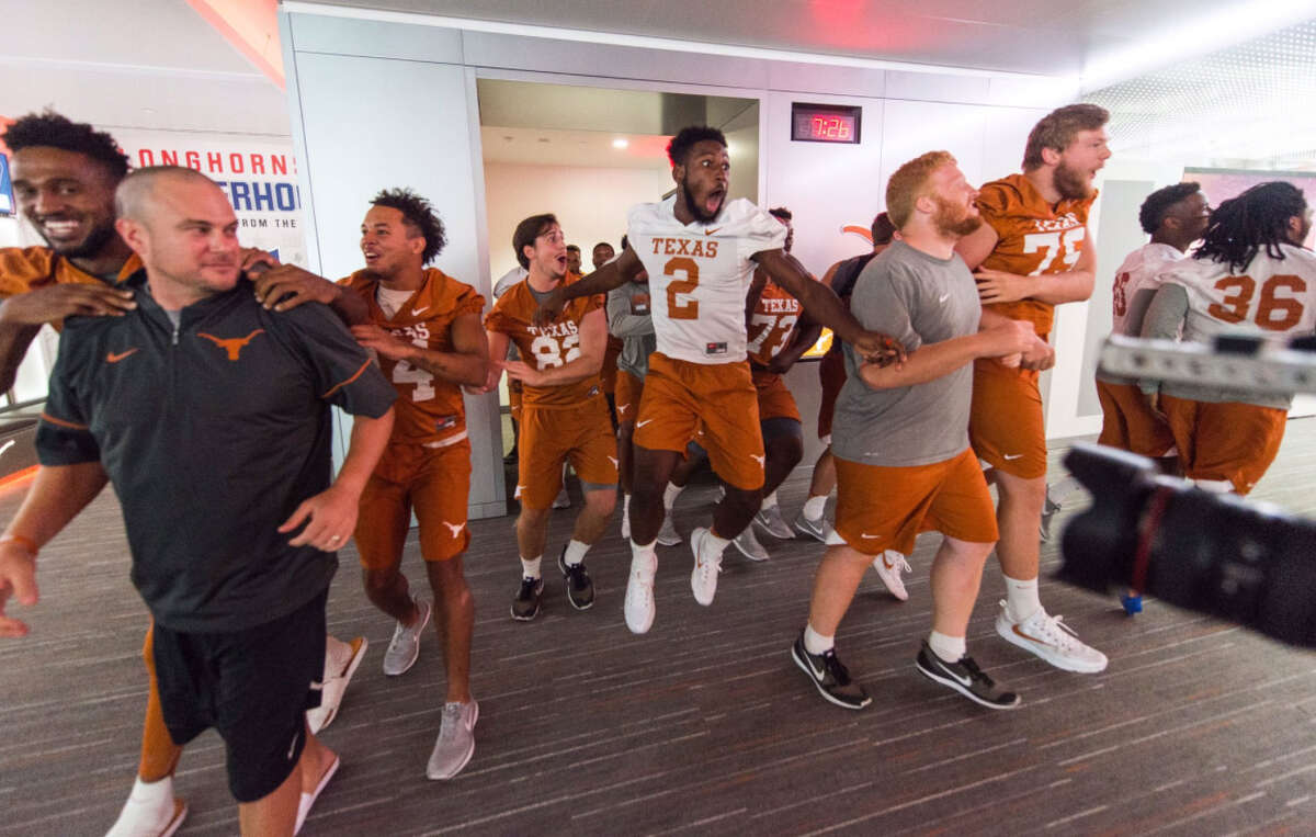 PHOTOS: Look inside the Texas Longhorns' new football locker room. The University of Texas unveiled their remodeled football locker room on Wednesday night. Each player's locker is estimated to have cost more than $8,700. Browse through the photos for a look inside the Texas Longhorns' upgraded locker room.