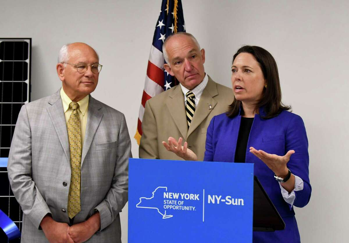U.S. Rep. Paul Tonko, left, Scott Stevens, president of Dimension Fabricators, center, and Alicia Barton, president and CEO of NYSERDA speaks during a ribbon cutting event for a new solar array which was installed at Dimension Fabricators on Thursday, Aug. 3, 2017, in Glenville, N.Y. (Will Waldron/Times Union)