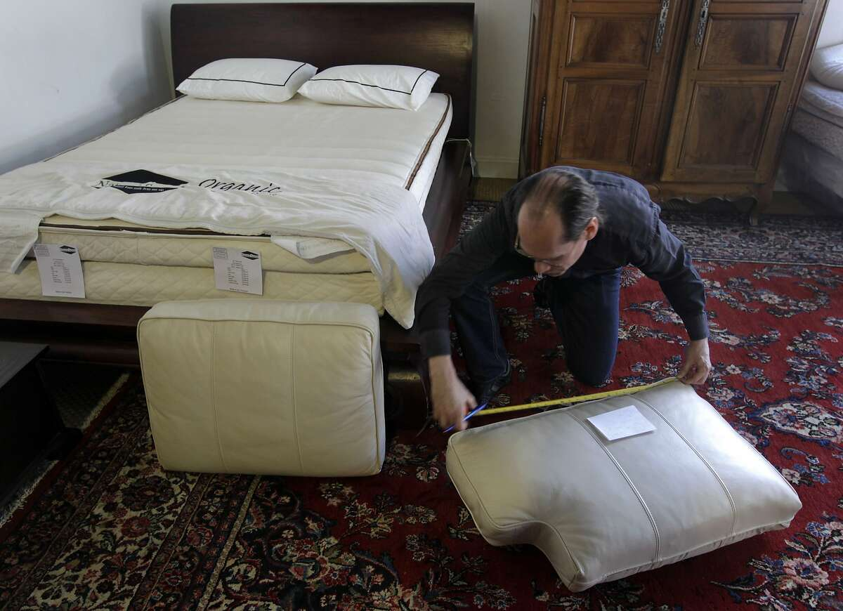 Alan Buhtz takes measurements of sofa cushions brought into the Foam Order showroom by customer Lori Yonelunas in San Francisco, Calif. on Tuesday, June 17, 2014. Consumers can swap out cushions containing toxic flame retardant material for safer toxic-free foam at a deep discount through a program organized through the Green Science Policy Institute.