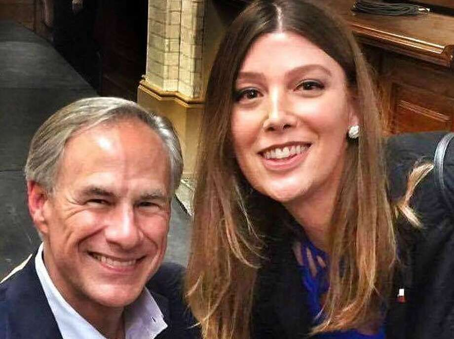 Ashley Smith of San Antonio posted this photo showing her pose with Gov. Greg Abbott at his July 2017 campaign kickoff (Facebook post).