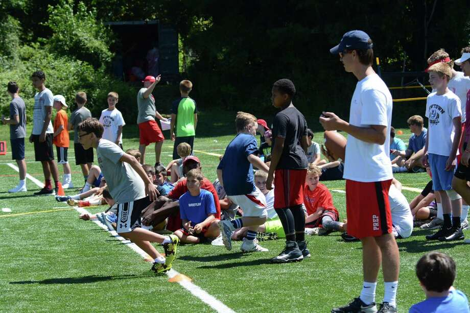 A camper breaks from the line during a running drill at the Fairfield Prep Summer Football Camp. Photo: Contributed Photo /