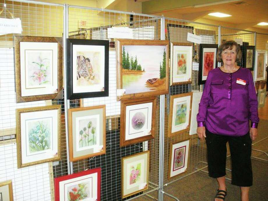 Group founder Carole Krecioch stands with her artwork from the 2016 show. (Photo provided)