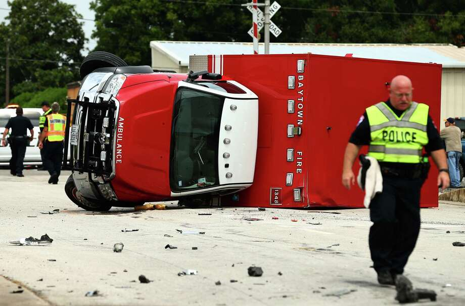 First responders injured when Baytown ambulance rolls over in T ...