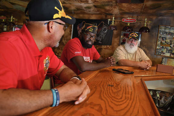 Veterans Mike Donald (US Army), from left, Ray Taylor (US Army), and George Pitts (USAF), chat at the bar in The Bunker at the Tomball VFW Post 2427. (Photo by Jerry Baker/Freelance)