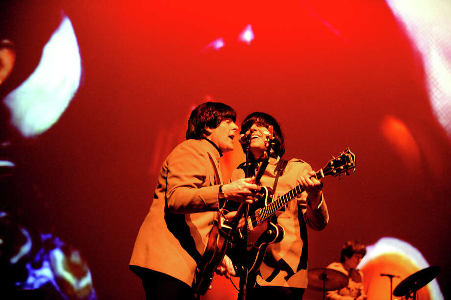 The Liverpool Legends Beatles Tribute Band perform Wednesday night at the Jefferson Theatre. Photo taken Tuesday, February 7, 2017. / The Observer
