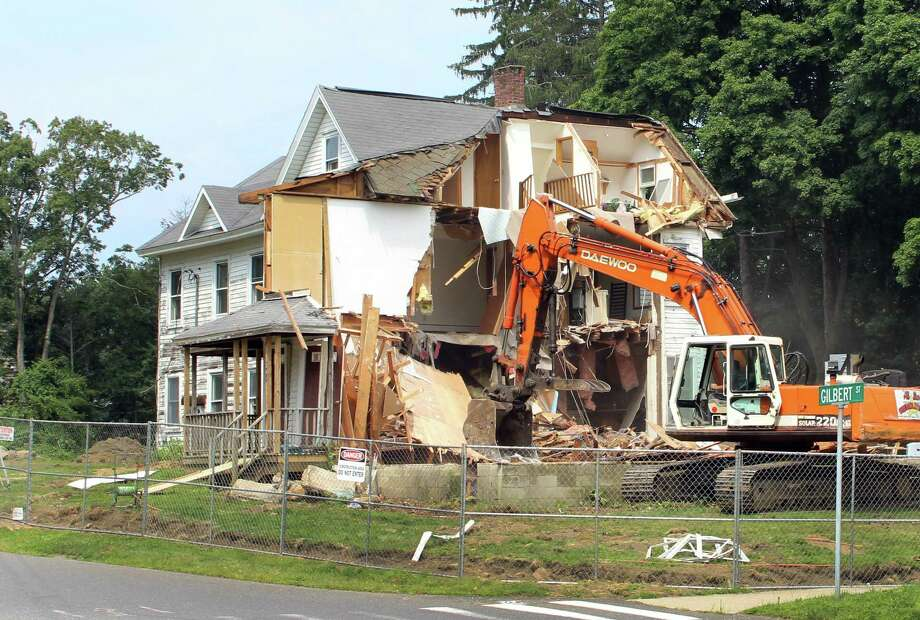 A century-old home on Main Street was demolished Wednesday to make room for a new development. An investment group, 509 Main Street, LLC, was approved last year to build five single-family homes on the one-acre property. Photo: Anna Quinn / Brian Koonz / The News-Times