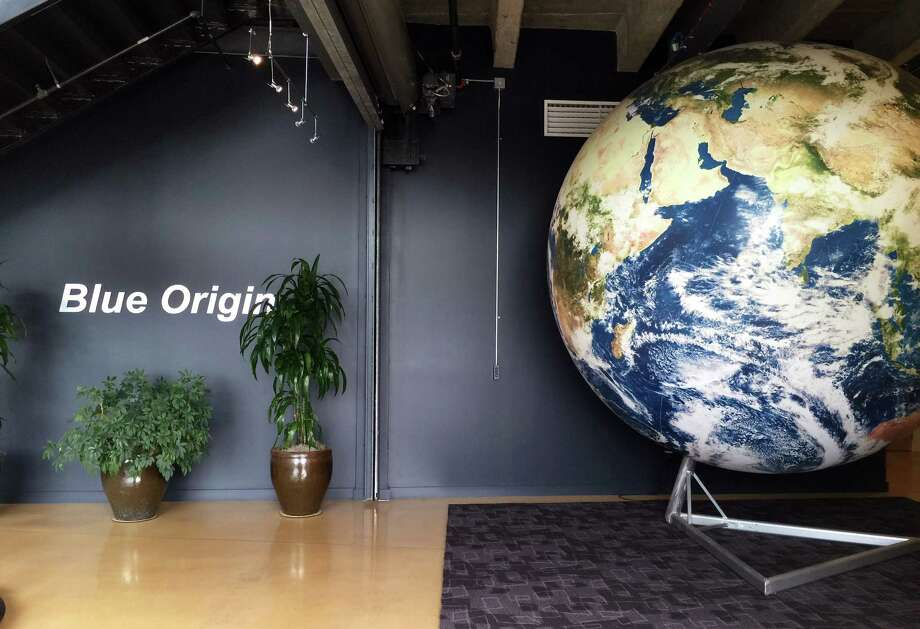 The lobby of space venture Blue Origin features a replica of the Earth, Tuesday, March 8, 2016, in Kent, Wash. The private space company opened its doors to the media for the first time on Tuesday to give a glimpse of how organizations like Blue Origin are creating the next generation of rockets for private and public use. (AP Photo/Donna Blankinship) Photo: Donna Blankinship, STF / Copyright 2016 The Associated Press. All rights reserved. This material may not be published, broadcast, rewritten or redistribu