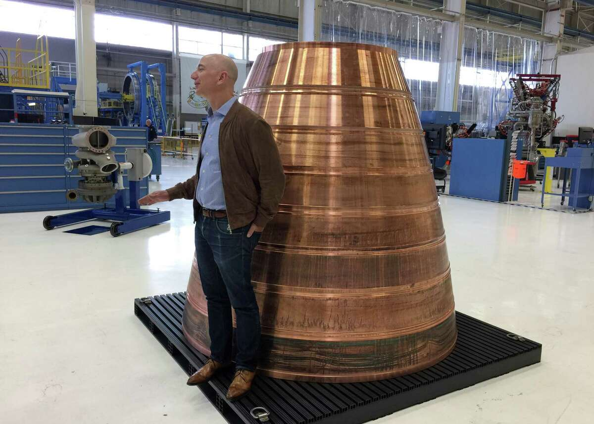 Keep going for a look at the plans for the Houston Spaceport. Amazon.com founder Jeff Bezos stands next to a copper exhaust nozzle to be used on a space ship engine during a media tour of Blue Origin, the space venture he founded, Tuesday, March 8, 2016, in Kent, Wash. The private space company opened its doors to the media for the first time on Tuesday to give a glimpse of how organizations like Blue Origin are creating the next generation of rockets for private and public use. (AP Photo/Donna Blankinship)
