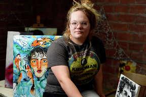 Madison Stuckey poses in her studio space at The Art Studio, Inc.  Photo taken Thursday 7/27/17 Ryan Pelham/The Enterprise