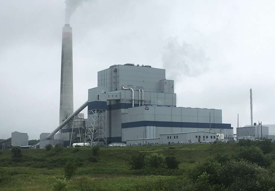 EPA head Scott Pruitt reversed his decision to delay implementation of Obama-era rules reducing emissions of air pollutants at such entities as this power plant in Maidsville, W.Va. Photo: Michael Virtanen, Associated Press