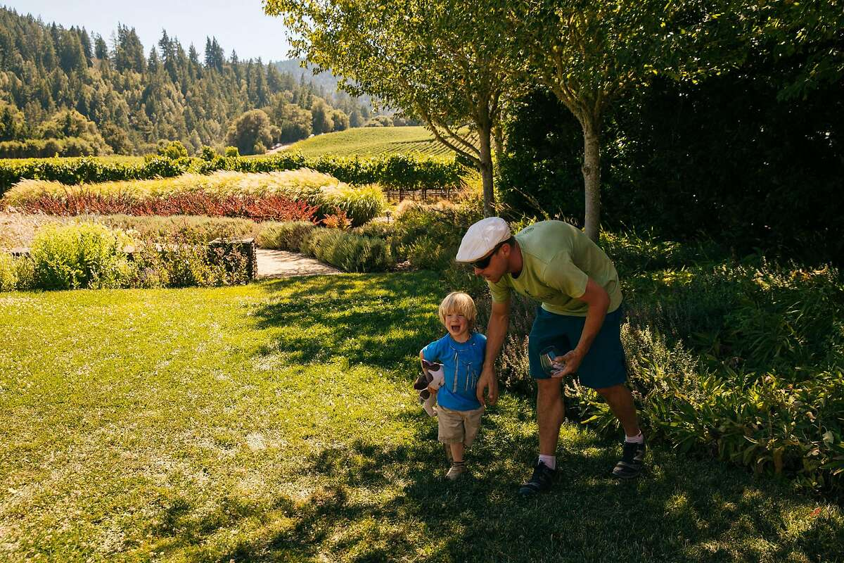 Daniel Gray and his two-year old son, Gavin Gray, walk one outdoor patio of Goldeneye Winery in Philo, Calif. Thursday, July 27, 2017.