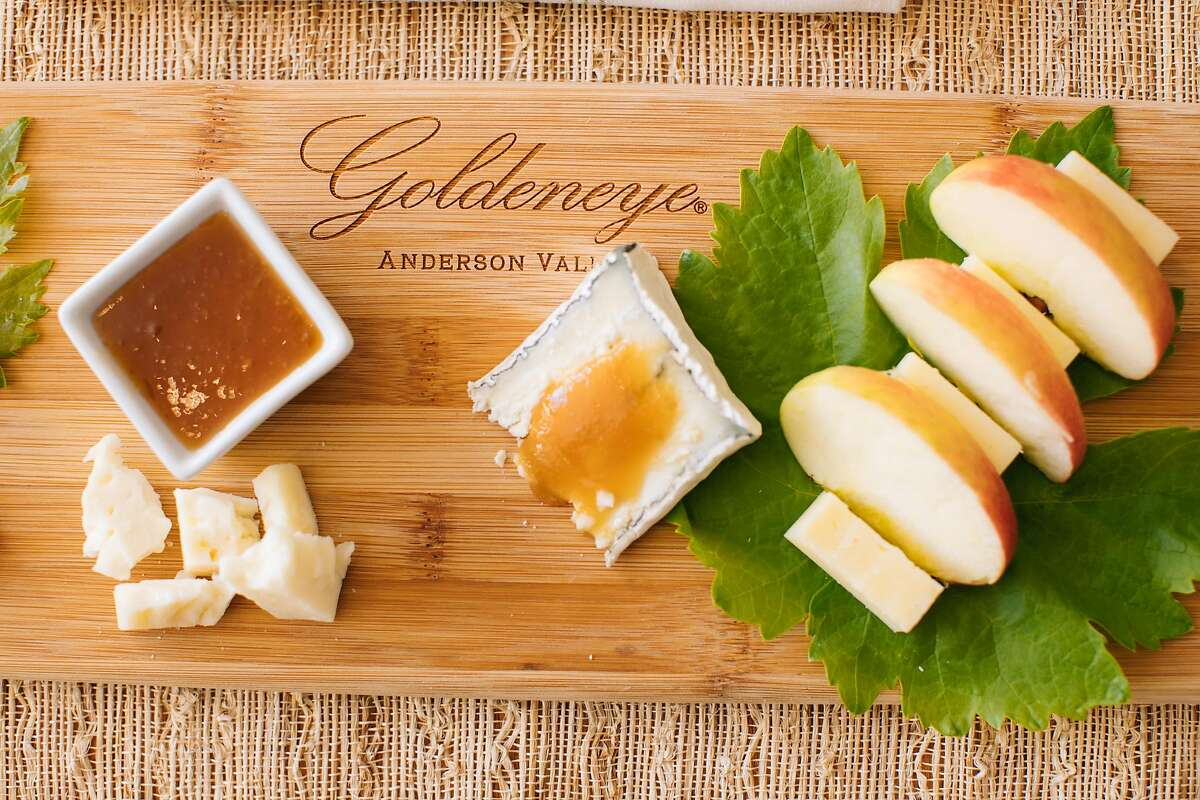 A Goldeneye Winery cutting board with a cheese, apple and jam spread photographed at the tasting room in Philo, Calif. Thursday, July 27, 2017.