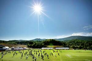 The Houston Texans warm up at the beginning of practice during training camp at the Greenbrier on Thursday, Aug. 3, 2017, in White Sulphur Springs, W.Va.