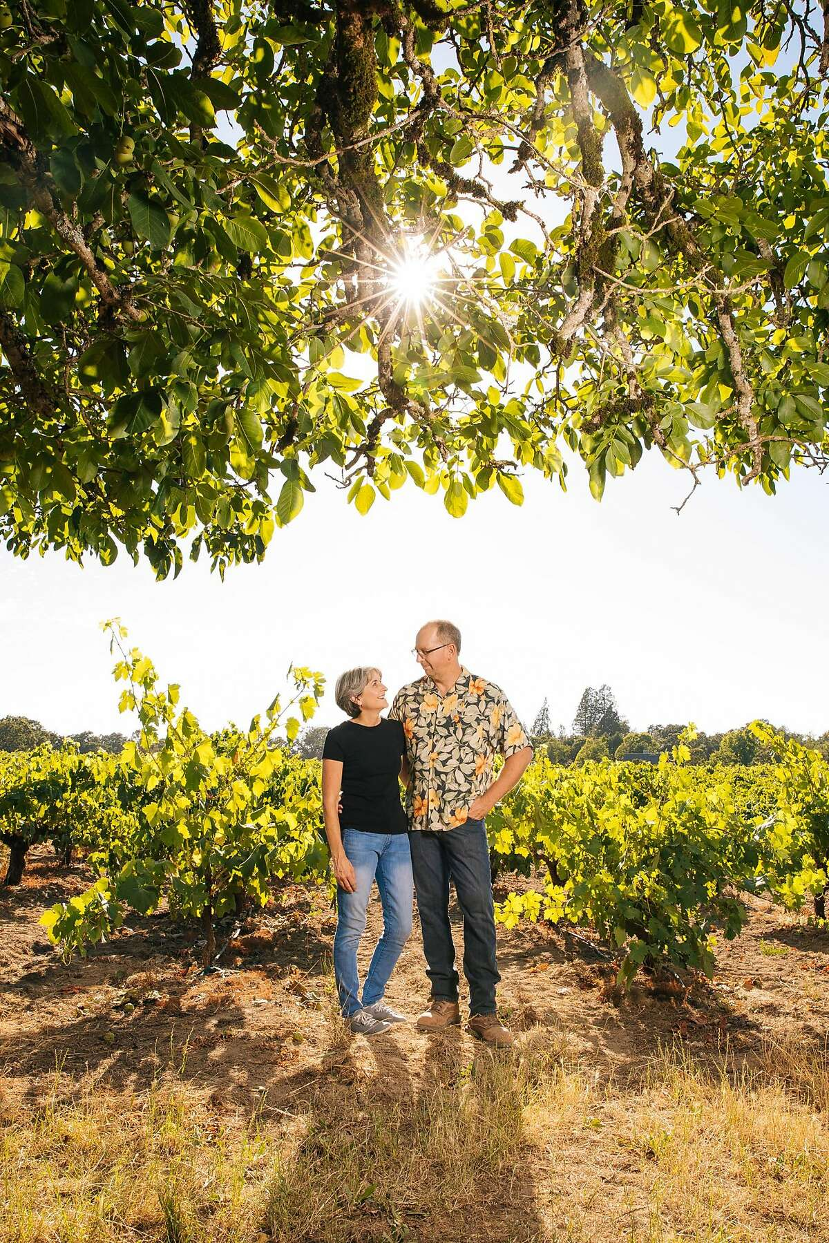Mike Officer and Kendall Officer, owners of the Carlisle Winery and Vineyard, photographed in the Carlisle Vineyard in Windsor, Calif. Saturday, July 22, 2017.