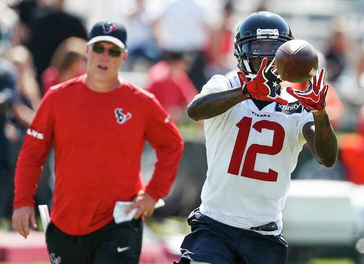 Houston Texans wide receiver DeAndrew White (12) makes a catch in front of wide receivers coach John Perry during training camp at the Greenbrier on Thursday, Aug. 3, 2017, in White Sulphur Springs, W.Va.