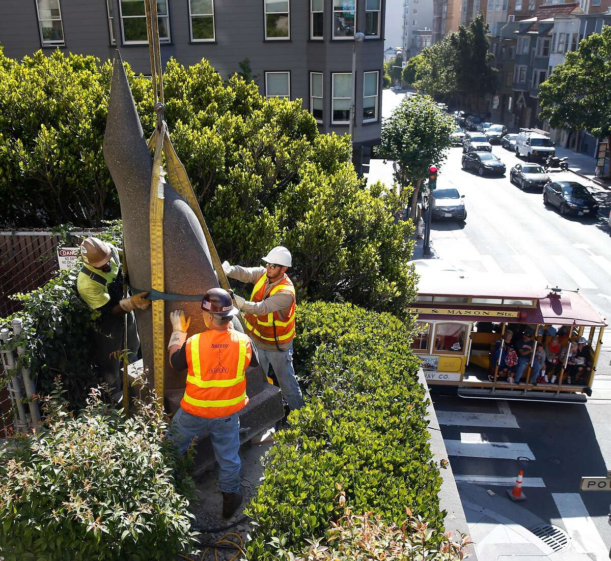 A penguin sculpture by Beniamino Bufano installed in the back corner of the Stanford Court Hotel is prepped for removal by a crane crew from its perch above Pine and Powell streets in San Francisco, Calif. on Saturday, July 22, 2017. The penguin will be restored and reinstalled in the main entrance to the hotel, which is undergoing a renovation, on California Street.