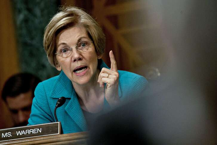 Senator Elizabeth Warren, a Democrat from Massachusetts, questions Randal Quarles, governor of the U.S. Federal Reserve nominee for U.S. President Donald Trump, not pictured, during a Senate Banking Committee nomination hearing in Washington, D.C., U.S., on Thursday, July 27, 2017. Trumps pick to be the Federal Reserves top Wall Street watchdog said it's time to reconsider the restrictions imposed on banks in recent years, even as he credited regulations with helping stabilize the financial system after the 2008 crisis. Photographer: Andrew Harrer/Bloomberg
