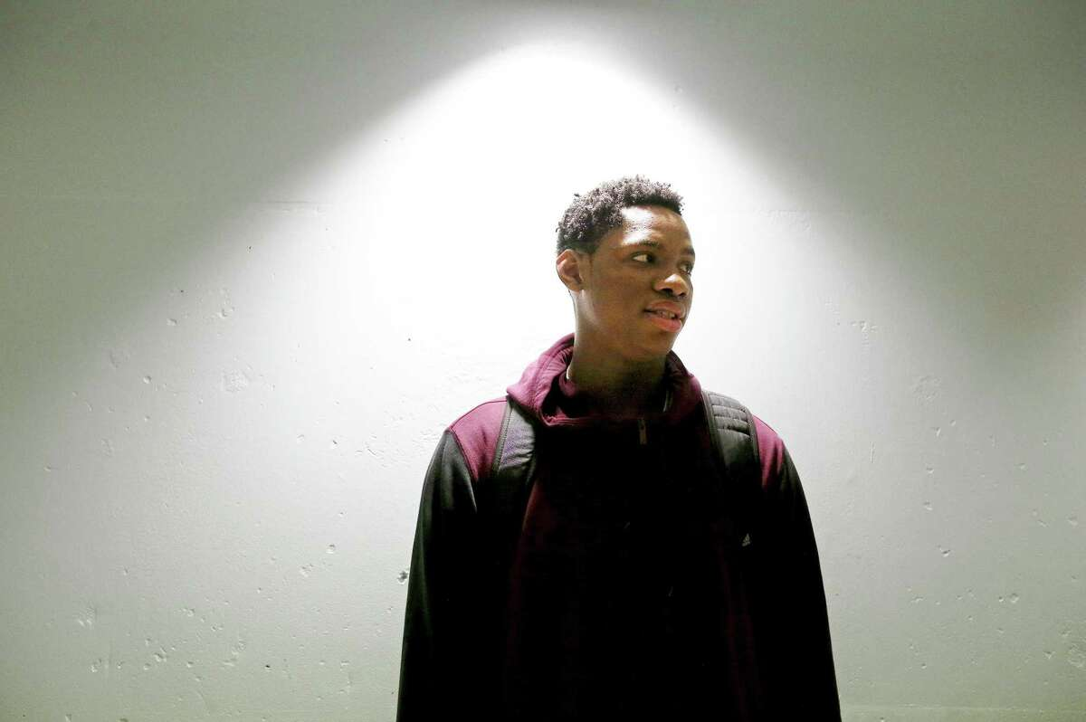 St. Anthony's Charles Bassey pauses in the hallway before the game with Virginia Episcopal School at the Nassau Community College gym in Garden City, N.Y., in February 2017.