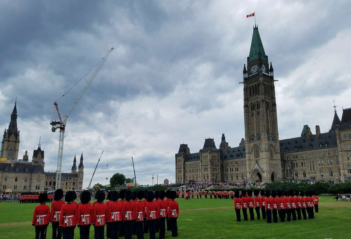 Kilts, scarlet coats and bear fur hats are part of the changing of the guard at Parliament in Ottawa, Ontario, Canada, in 2017. (Teresa Buckley/Times Union)