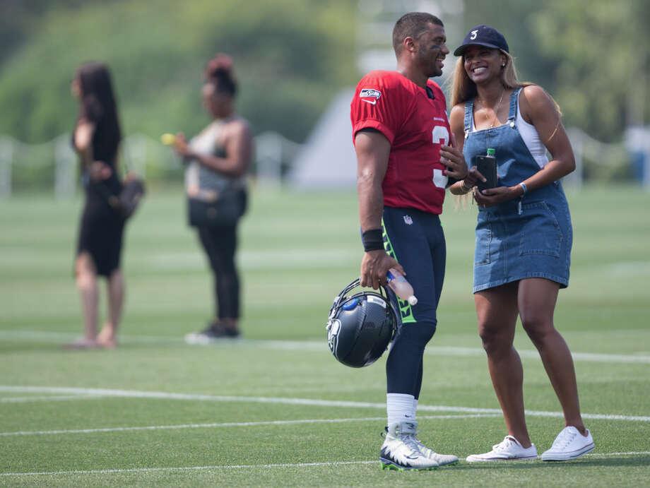 Seahawks quarterback Russell Wilson talks with his wife Ciara Princess Harris following training camp, at Virginia Mason Athletic Center on Thursday, Aug. 3, 2017. Photo: GRANT HINDSLEY, SEATTLEPI.COM / SEATTLEPI.COM