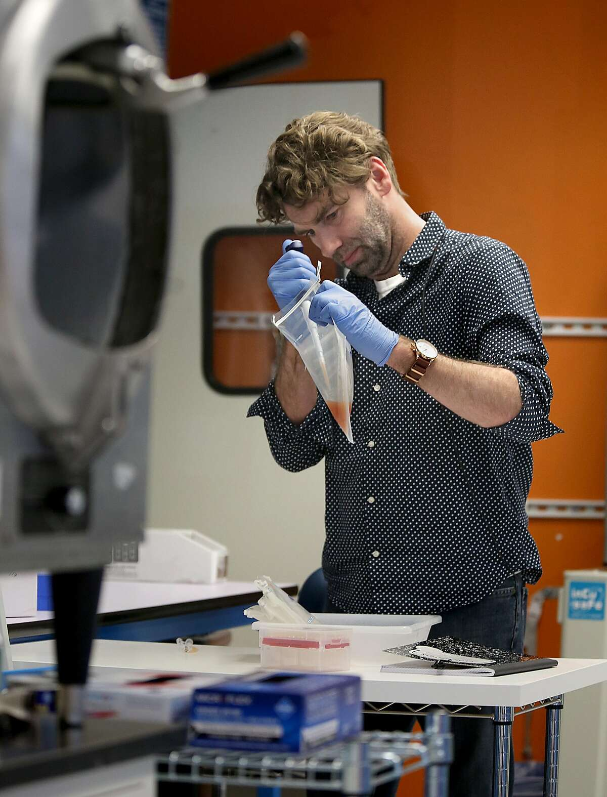 Senior scientist Chris Haney takes a sample of water rinsed from chicken skin to do an analysis at Clear Labs which conducts DNA sequencing and analysis of food samples on Thursday, July 27, 2017, in Menlo Park, Calif.