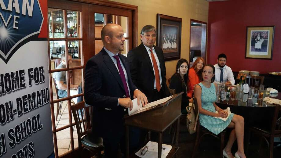 Luke Doebele (left) and Pete Serna (right) of Serna Insurance introduce the presentation of the Texan Live Scholarship Foundation scholarship awards at the luncheon on August 1 Photo: Texan Live