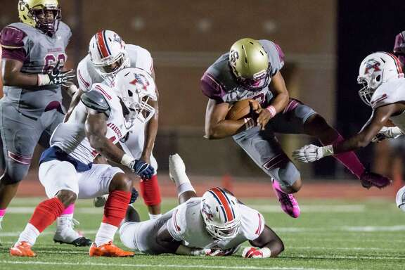 Summer Creek quarterback John Holcombe (3) dives forward for a first down in a high school football game at Turner Stadium on Friday, October 14, 2016, in Humble. (Joe Buvid / For the Houston Chronicle)
