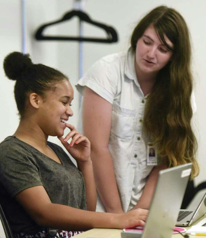 Leah Attai, left, a rising junior at Greens Farms Academy in Westport, and Melissa Wilson, a rising junior at Stratford High School, work together during the 7-week Girls Who Code summer program at the Synchrony Financial headquarters in Stamford July 6. Photo: Tyler Sizemore / Hearst Connecticut Media / Greenwich Time