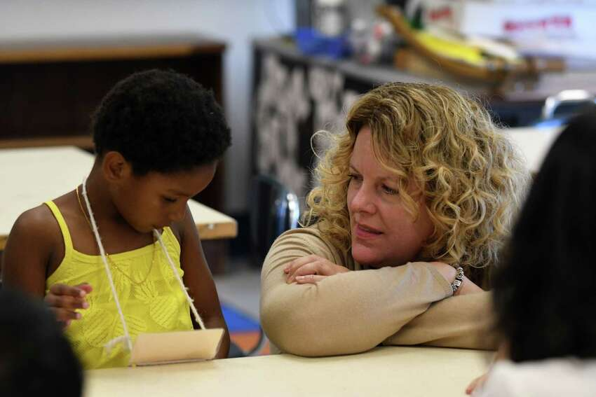 Rachel Stead, principal of the Newcomer Program, speaks to Yeritza Morbah, a Newcomer student from the Dominican Republic, on Tuesday, Aug. 1, 2017, at North Albany Academy in Albany, N.Y. (Will Waldron/Times Union)