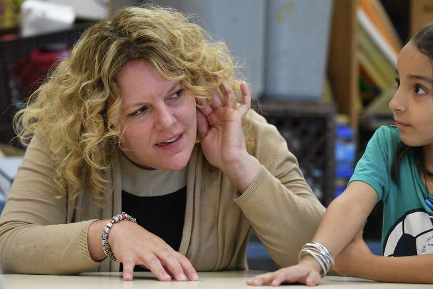 Rachel Stead, principal of the Newcomer Program, speaks with Newcomer students on Tuesday, Aug. 1, 2017, at North Albany Academy in Albany, N.Y. (Will Waldron/Times Union)