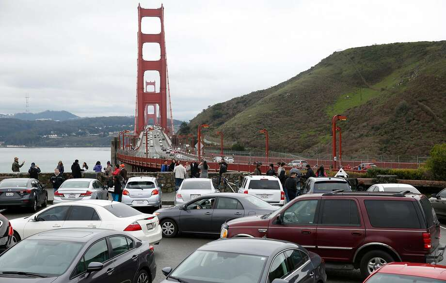 Motorists waiting for parking spaces to open up create a logjam at the north Vista Point of the Golden Gate Bridge in Sausalito. During peak times, northbound traffic attempting to exit into Vista Point's parking lot backs up, creating significant congestion coming off the bridge. Photo: Paul Chinn, The Chronicle
