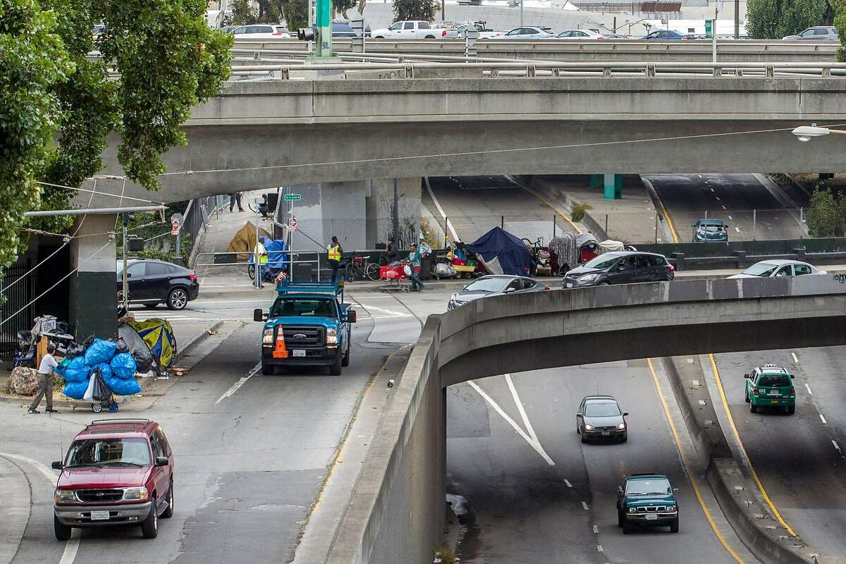 Highway 101 over Cesar Chavez Street and Potrero Avenue in San Francisco is a tangle of streets, with homeless people camping under overpasses.