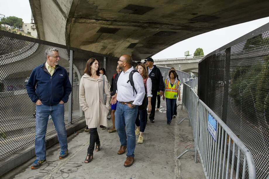 From left: Department of Homelessness and Supportive Housing director Jeff Kositsky, District 9 Supervisor Hillary Ronen and Department of Homelessness spokesperson Randy Quezada inspect the area near Cesar Chavez Street and Potrero Avenue on Wednesday, July 26, 2017, in San Francisco, Calif. Photo: Santiago Mejia, The Chronicle