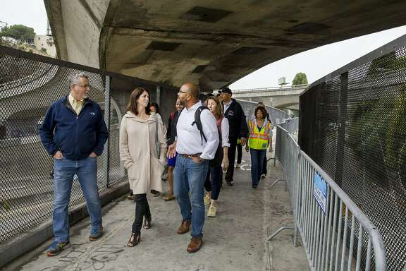 From left: Department of Homelessness and Supportive Housing director Jeff Kositsky, District 9 Supervisor Hillary Ronen and Department of Homelessness spokesperson Randy Quezada inspect the area near Cesar Chavez Street and Potrero Avenue on Wednesday, July 26, 2017, in San Francisco, Calif.