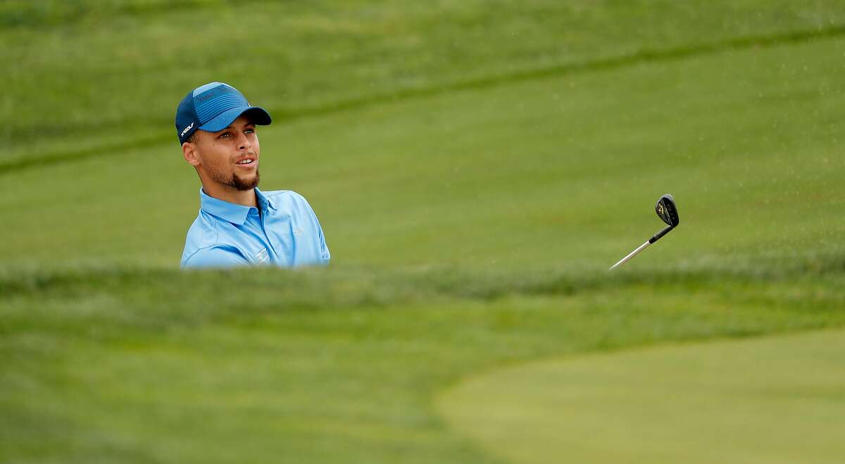 Golden State Warriors star Stephen Curry watches his bunker shoton the 14th hole during the first round of the Ellie Mae Classic golf tournament at TPC Stonebrae in Hayward, Ca., on Thurs. August 3, 2017.