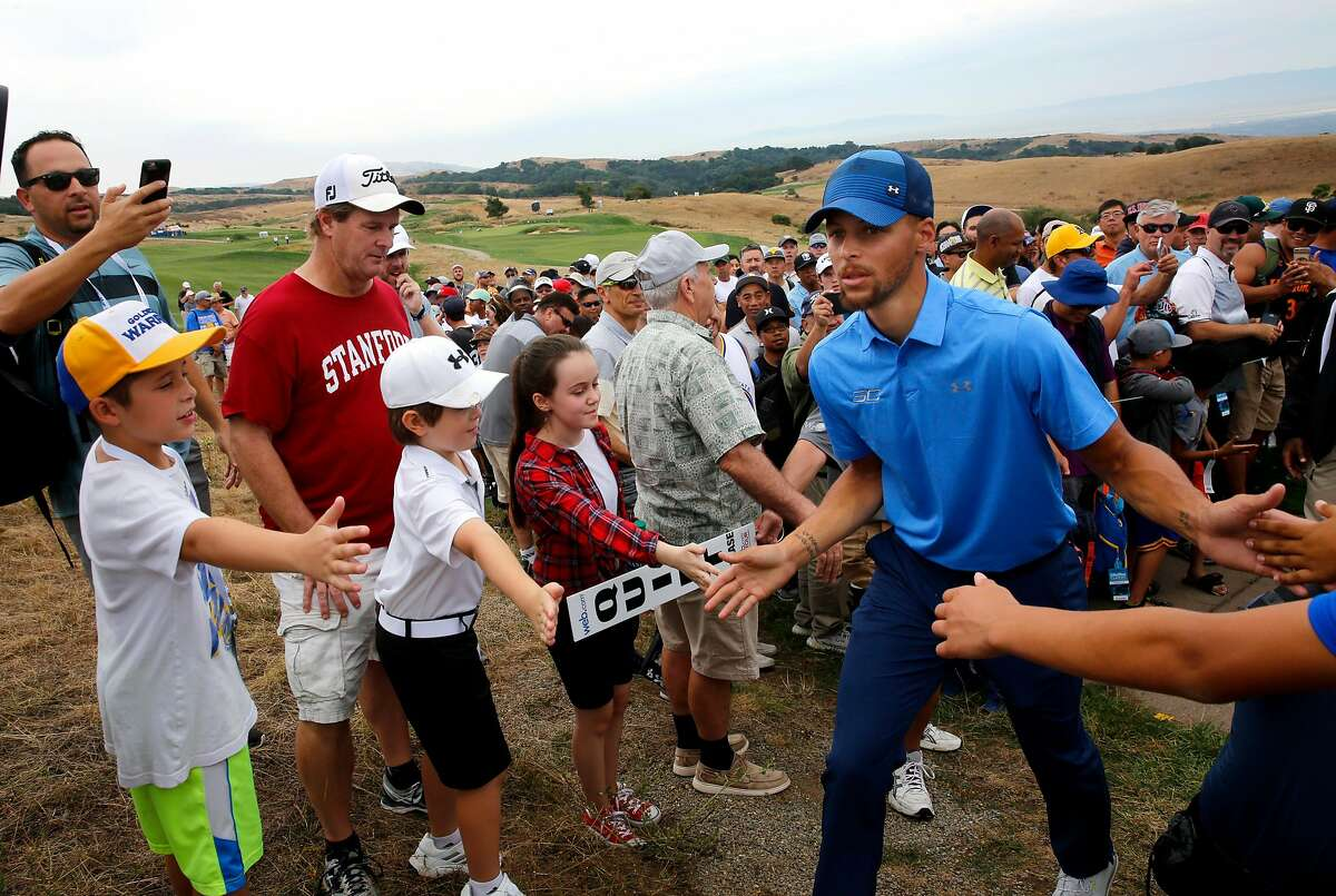 Golden State Warriors star Stephen Curry makes his way to the 18th tee as he greets fans during the first round of the Ellie Mae Classic golf tournament at TPC Stonebrae in Hayward, Ca., on Thurs. August 3, 2017.
