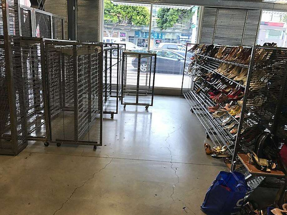 Empty racks and spare merchandise at the soon-to-close Goodwill. Photo: Leah Garchik, San Francisco Chronicle