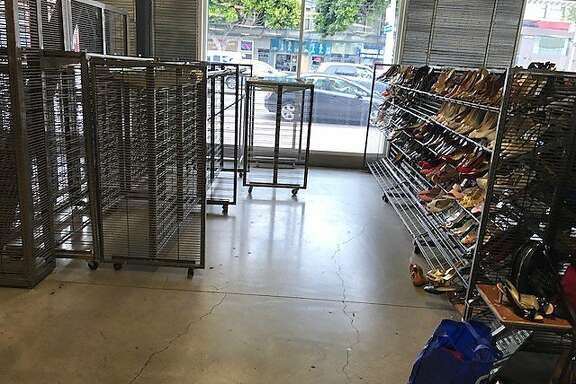 Empty racks and spare merchandise at soon-to-close Goodwill