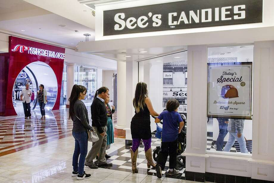Customers head into a familiar white-themed See's Candies shop at the Stonestown Galleria in San Francisco. Photo: Santiago Mejia, The Chronicle