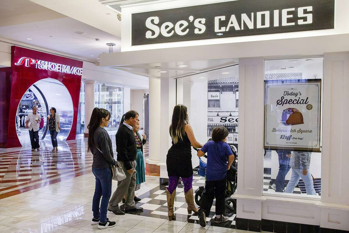 People head into See's Candies at the Stonestown Galleria on Tuesday, Aug. 1, 2017, in San Francisco, Calif.