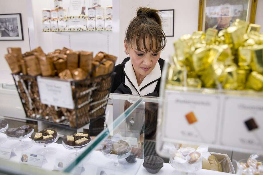 Editha Bonifacio stocks chocolate at See's Candies inside the Stonestown Galleria. Photo: Santiago Mejia, The Chronicle