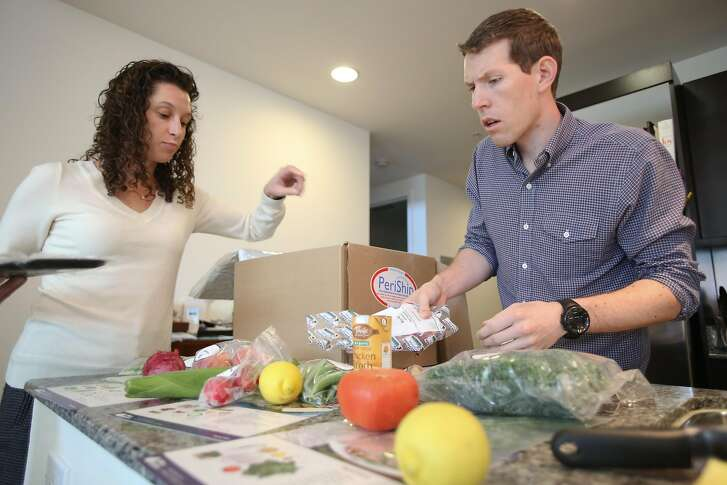 Julie Ingalls and Justin Overdorff sort through their first delivery from Blue Apron in San Francisco on August 20, 2013. Blue Apron is a new company that delivers weekly recipes and all the pre-measured ingredients to make three home-cooked meals a week to your door.