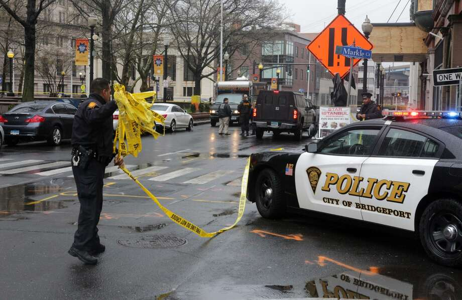 Police are investigating the shooting death of a Stamford man on the McLevy Green on State Street, between Main Street and Broad Street in Bridgeport, Conn. on April 20, 2017. Photo: Cedar Attanasio / Hearst Connecticut Media / Connecticut Post