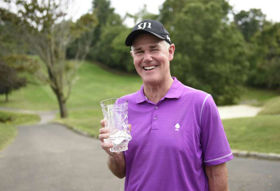 Men's senior champion Mark Vassalotti poses with his championship cup at the Stamford Amateur Golf Championship at the E. Gaynor Brennan Golf Course in Stamford, Conn. Sunday, Sept. 18, 2016. Photo: Tyler Sizemore / Hearst Connecticut Media / Greenwich Time