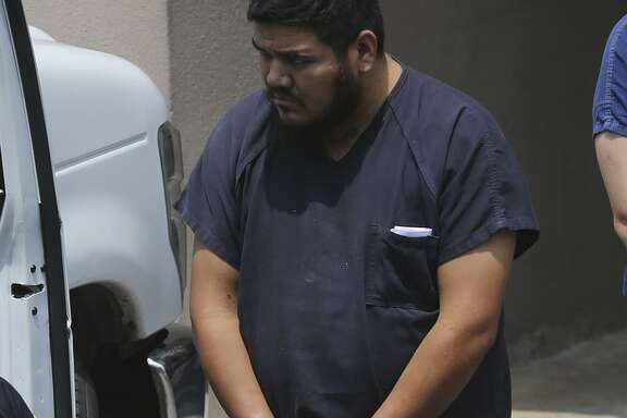 German Hrnandez-Chavez is led to a van Thursday August 3, 2017 behind the John H.Wood, Jr. Federal Courthouse. Harnandez-Chavez is being held as a material witness in the case of the tractor trailer rig that was found recently in a Wal-Mart parking lot with dead and dying immigrants in its trailer.
