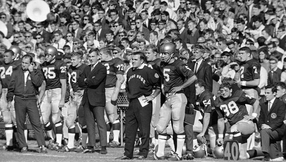 FILE - In this Nov. 18, 1967, file photo, Notre Dame head coach Ara Parseghian and quarterback Terry Hanratty (5) watch Georgia Tech kick a field goal during the first quarter of a college football game, in Atlanta, Ga. Parseghian, who took over a foundering Notre Dame football program and restored it to glory with two national championships in 11 seasons, died Wednesday, Aug. 2, 2017, at his home in Granger, Ind. He was 94. (AP Photo/File) Photo: Anonymous / Associated Press / AP1967