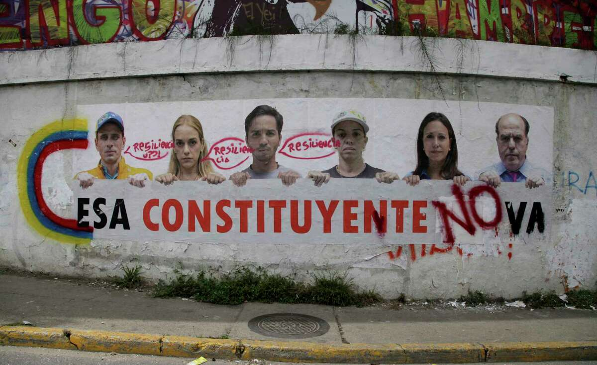 A poster that shows some of Venezuela's opposition leaders holding a sign with a message that reads in Spanish: